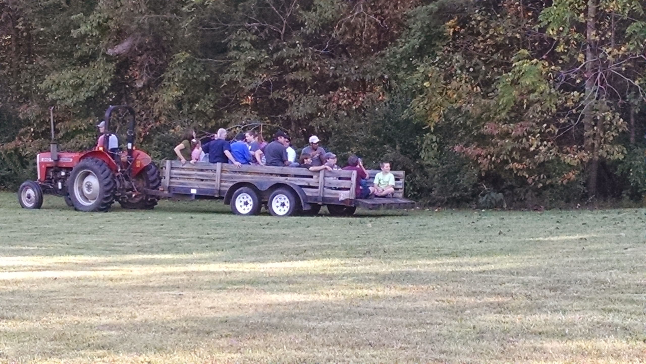 Group of people enjoying a tractor ride at an NC Fragile X event.