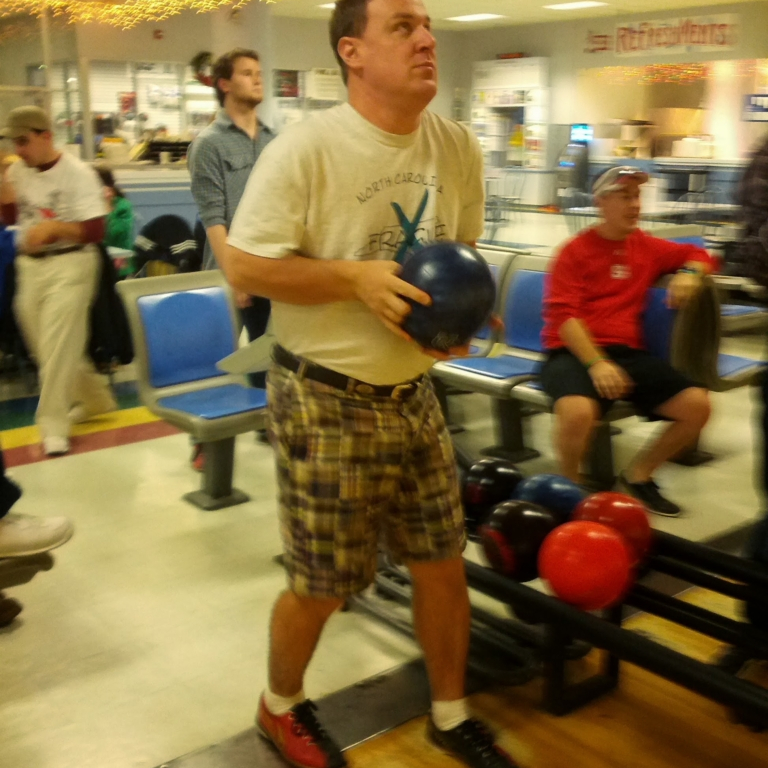 Gentleman at the NC Fragile X Bowl-A-Thon winding up to roll a strike.
