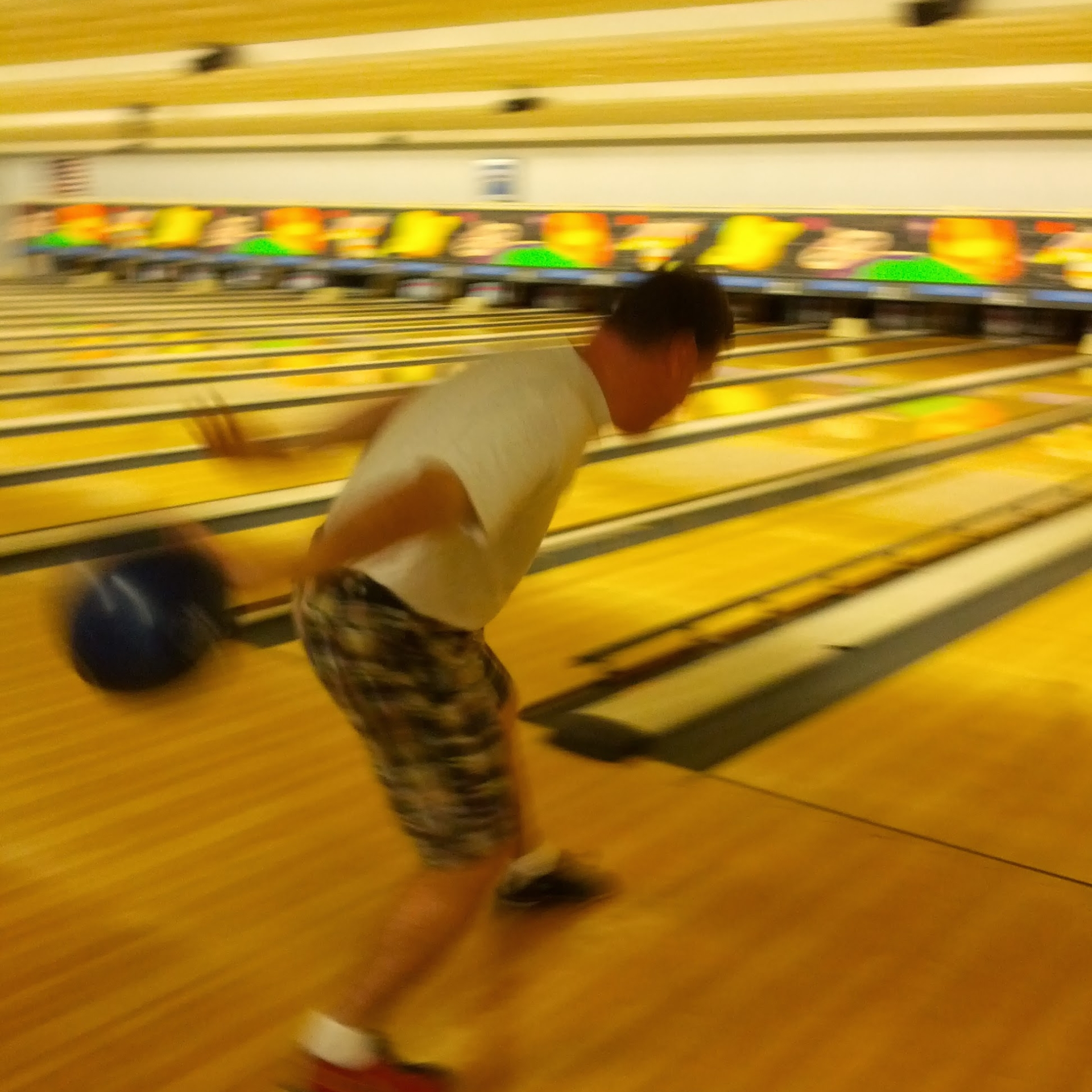 Gentleman winding up his bowling swing at the NC Fragile X Foundation Bowl-A-Thon.