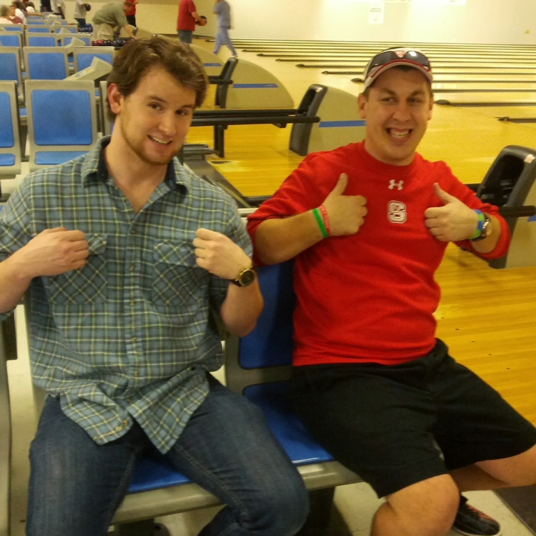 Two attendies of the NC Fragile X Bowl-A-Thon giving two thumbs up!