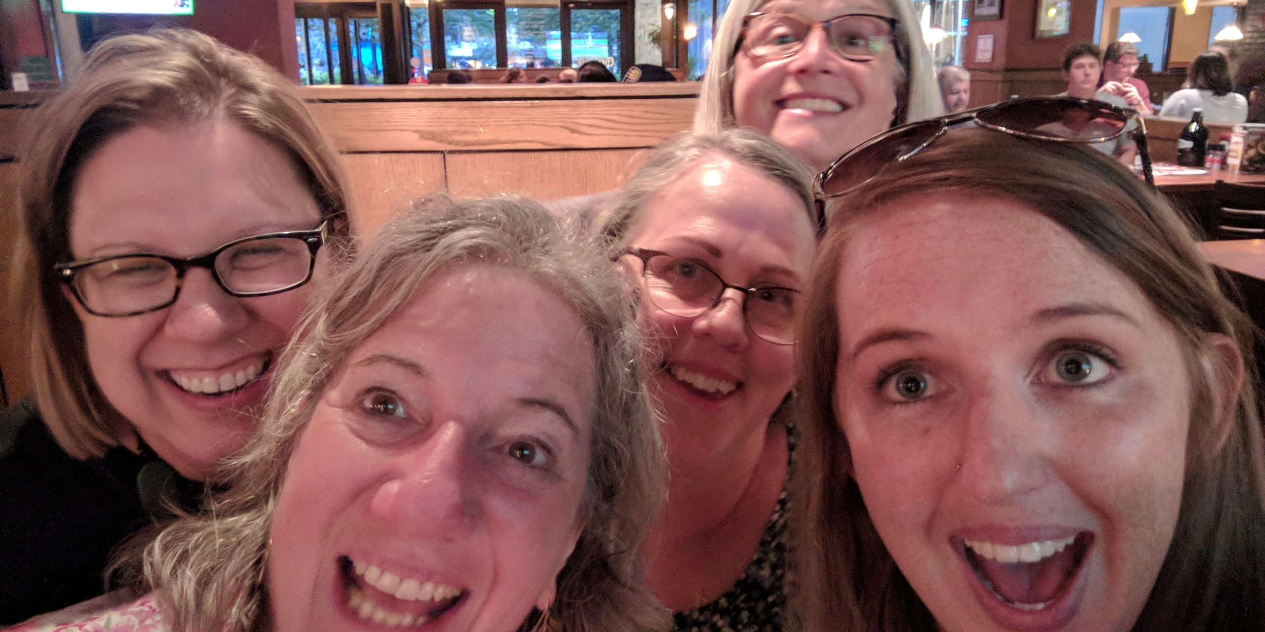 Women posing for a selfie group photo at an NC Fragile X event!